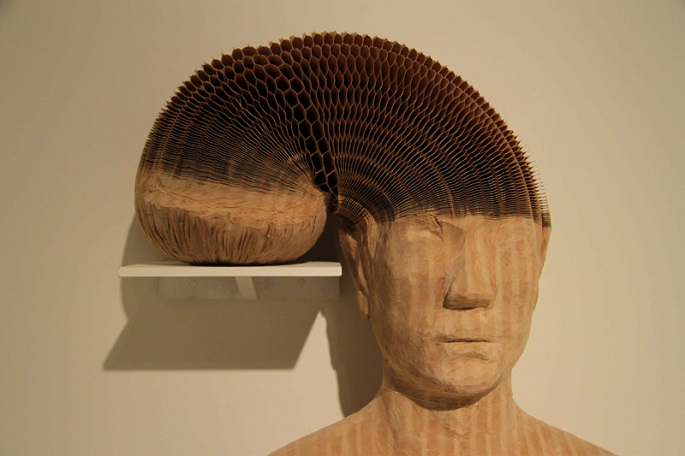 """""""What at first look like delicate works of carved porcelain are actually thousands of layers of soft white paper, carved into busts, skulls, and human forms by Li Hongbo.""""  Bizarre paper sculptures by Li Hongbo li hongbo made of paper 06"""