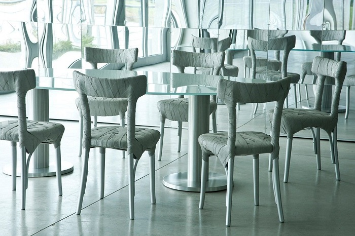 """""""Peter Traag is a furniture designer born in Tegelen in the Netherlands. He developed a new way of making exclusive furniture by hand.""""  Peter Traag modern furniture designs original design chairs 4164 4106899"""