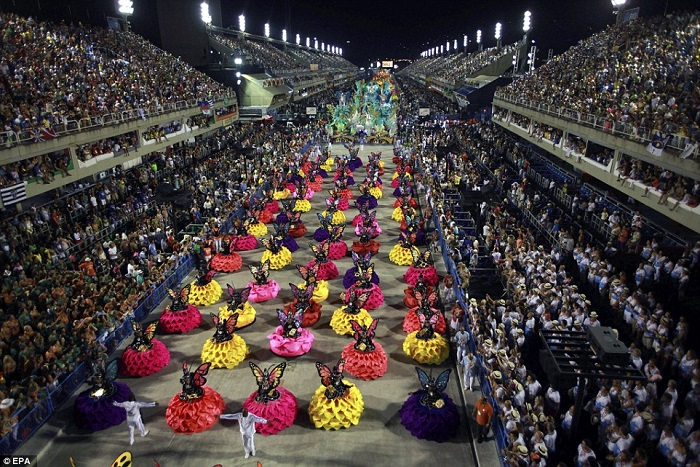 """""""This year, as always, Rio de Janeiro's Carnival last night ended as glittering as he should. Blaring music and scantily-clad dancers at the Sambadrome impressed the visitors."""" Brazilian Carnival The best of Brazilian Carnival 2015 The best of Brazilian Carnival 2015 performances i lobo you15"""