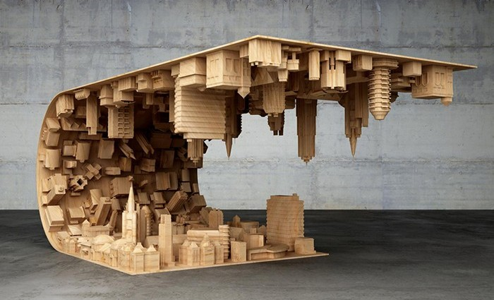 Stelios Mousarris, a Cyprus designer has realized the 'wave city' coffee table that bends a landscape of buildings in half.