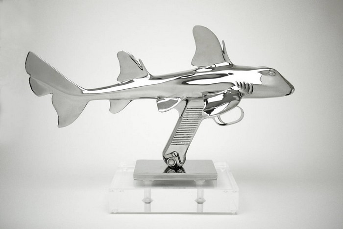 Schulz is an artist that has come up with these 3D metal sculptures, fusing sharks and rays with guns.