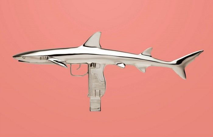 Christopher Schulz is an artist that has come up with these 3D metal sculptures, fusing sharks and rays with guns.