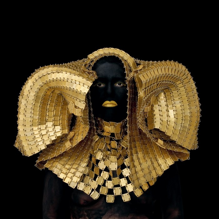 Kimiko Yoshida has created photos of herself in which she wears elaborate costumes that reference a wide range of subjects creating art photography.