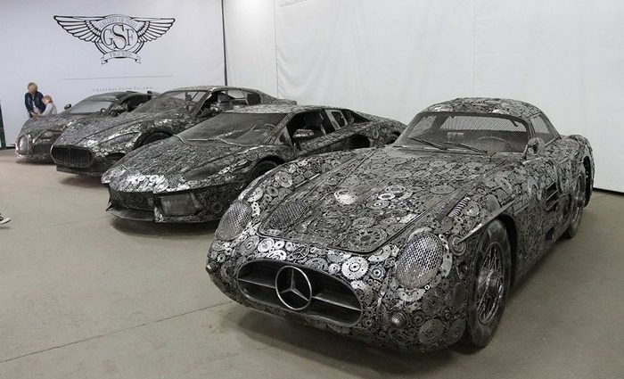 Fifty artists from across the globe have teamed up to create replicas of Recycled Metal luxury Cars.