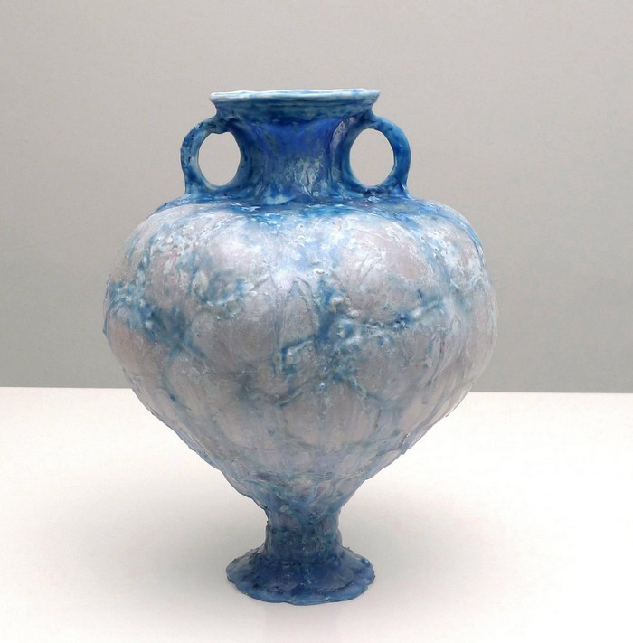 Shari Mendelson creates ceramic art inspired by historical ceramic, glass and metal artifacts and constructed from found plastic bottles.