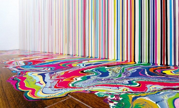 """Known for his colorful """"puddle"""" paintings, Ian Davenport has gone to great lengths in the name of experimentation creating colorful art."""