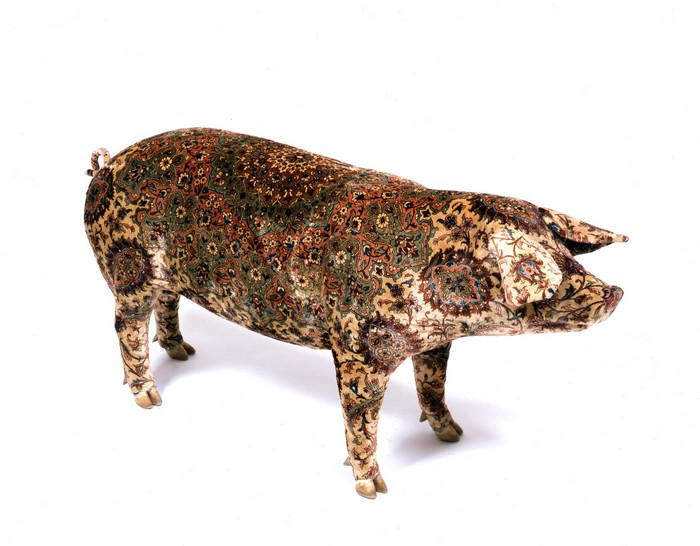 Wim Delvoyeis a Belgian artist whose controversial works vary from tattooed pigs to fancy tires, gothic works, and much more interesting things. Wim Delvoye Artistic Pig Tattoos by Wim Delvoye Artistic Pig Taxidermy by Wim Delvoye artists I Lobo you11