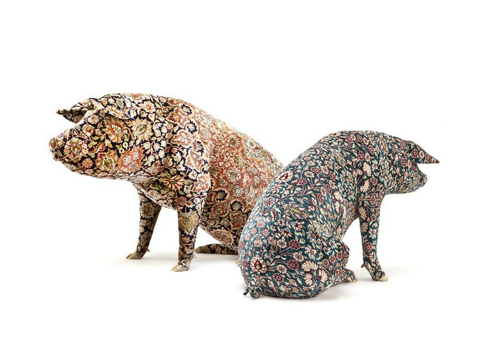 Wim Delvoyeis a Belgian artist whose controversial works vary from tattooed pigs to fancy tires, gothic works, and much more interesting things. Wim Delvoye Artistic Pig Tattoos by Wim Delvoye Artistic Pig Taxidermy by Wim Delvoye artists I Lobo you5