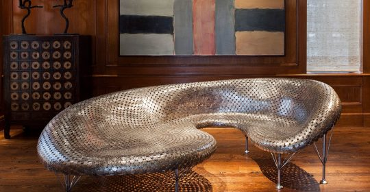 Johnny Swing is an American artist born in 1961. Among his catalog of works is a series of furniture made with coins.