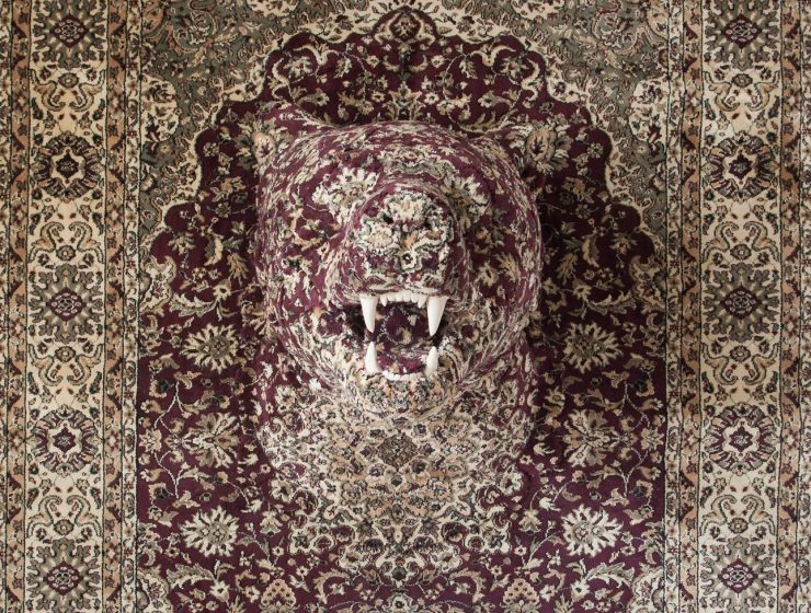 Debbie Lawson art installation is using Persian style rugs to decorate animals and insert them camouflaged in the rug's design.