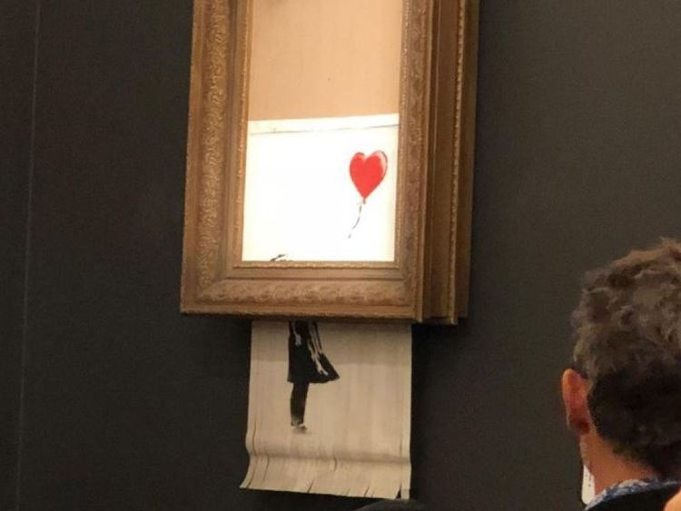 Banksy Banksy's painting sold at auction self-destroys minutes after Banksys painting sold at auction self destroys minutes after I Lobo you 5