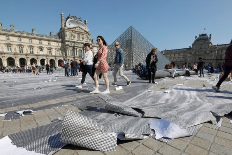 Louvre's Paper Art Installation Torned To Shreds By Visitors louvre Louvre's Paper Art Installation: A Mesmerizing Optical Illusion Effect Paper Art Installation Torned To Shreds By Visitors
